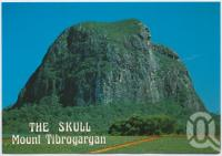 "<span class=""caption-caption"">The skull, the face of Mount Tibrogargan (354 metres)</span>, c1970-2000. <br />Postcard, collection of <span class=""caption-contributor"">Murray Views Collection</span>."